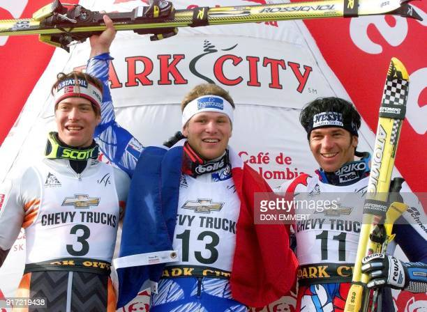 Winners of the men's World Cup slalom celebrate their victories 22 November in Park City Utah From left Norway's HansPetter Buraas second France's...