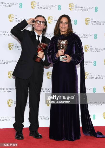 Winners of the Outstanding Contribution To Cinema award Stephen Woolley and Elizabeth Karlsen pose in the press room during the EE British Academy...
