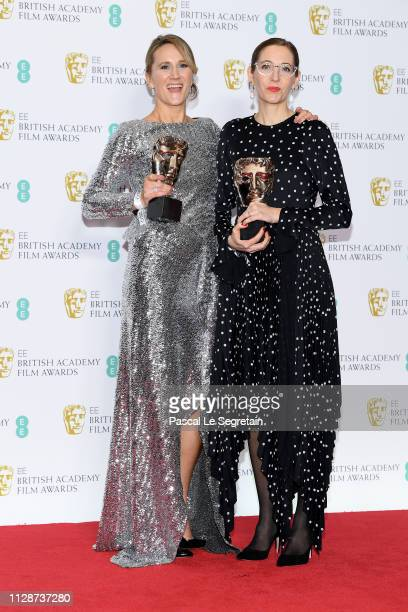 Winners of the Production Design award Alice Felton and Fiona Crombie pose in the press room during the EE British Academy Film Awards at Royal...