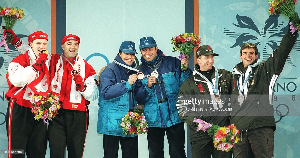 Winners of the two-man bobsleigh event at the Winter Olympics pose with their medals on the podium in Nagano 16 February. (L-R) Joint gold medal-winners Pierre Lueders and David MacEachern of Canada and Guenther Huber and Antonio Tartaglia and bronze medallists Christoph Langen and Markus Zimmermann.