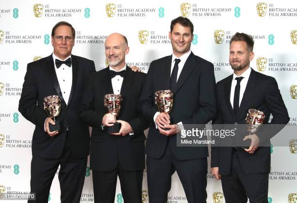 Winners of the Visual Effects award for Black Panther, Dan Sudick, Craig Hammack, Geoffery Baumann and Jesse James Chisholm pose in the press room...
