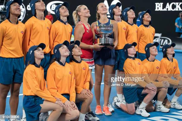 Winners of the Women's doubles Timea Babos of Hungary and Kristina Mladenovic of France with their trophy and the ball kids on day 12 of the 2018...