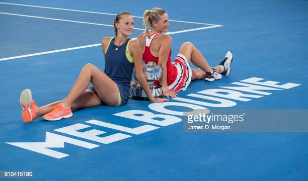 Winners of the Women's doubles Timea Babos of Hungary and Kristina Mladenovic of France with their trophy on day 12 of the 2018 Australian Open at...