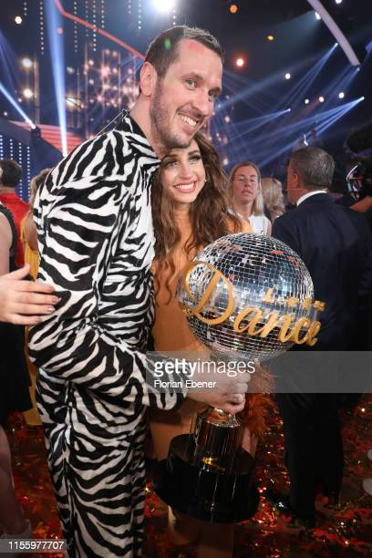 Winners Pascal Hens and Ekaterina Leonova pose on stage during the finals of the 12th season of the television competition Let's Dance on June 14...