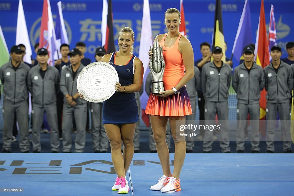 Winners Petra Kvitova of Czech and runners-up Dominika Cibulkova of Slovakia pose for a picture with their trophy on day 7 of 2016 Dongfeng Motor Wuhan Open at Optics Valley International Tennis Center on October 1, 2016 in Wuhan, China.