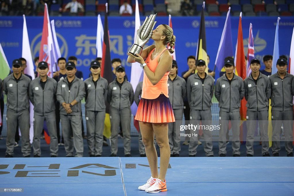 Winners Petra Kvitova of Czech pose for a picture with their trophy on day 7 of 2016 Dongfeng Motor Wuhan Open at Optics Valley International Tennis Center on October 1, 2016 in Wuhan, China.