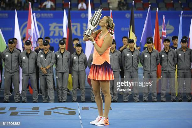 Winners Petra Kvitova of Czech pose for a picture with their trophy on day 7 of 2016 Dongfeng Motor Wuhan Open at Optics Valley International Tennis...