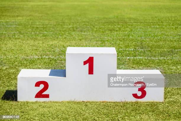 winners podium on grassy field - winners podium stock pictures, royalty-free photos & images