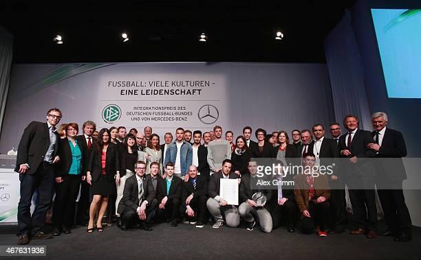 Winners pose with DFB President Wolfgang Niersbach, Shkodran Mustafi, Ilkay Guendogan, Christoph Kramer and Lukas Podolski during the DFB & Mercedes...