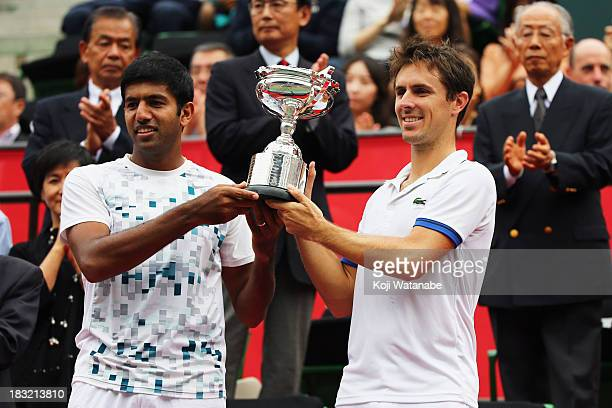 Winners Rohan Bopanna of India and Edouard RogerVasselin of France celebrate with their trophy after winning men's doubles final match against Jamie...