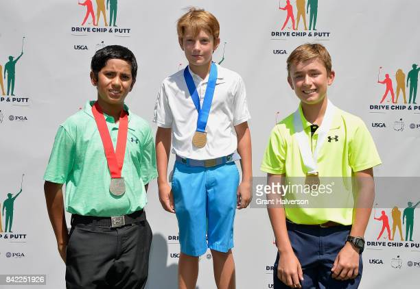 Winners Rohan Singh Holland Giles and Luke Walmet of the Boys 1213 Division of The Drive Chip and Putt Championship at Pinehurst Resort on September...