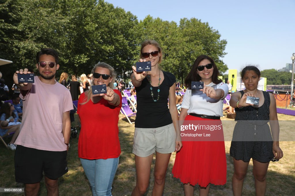 Winners show off their Running Warehouse gift cards during the WTA Tennis On The Thames in Bernie Spain Gardens on June 28, 2018 in London, England.