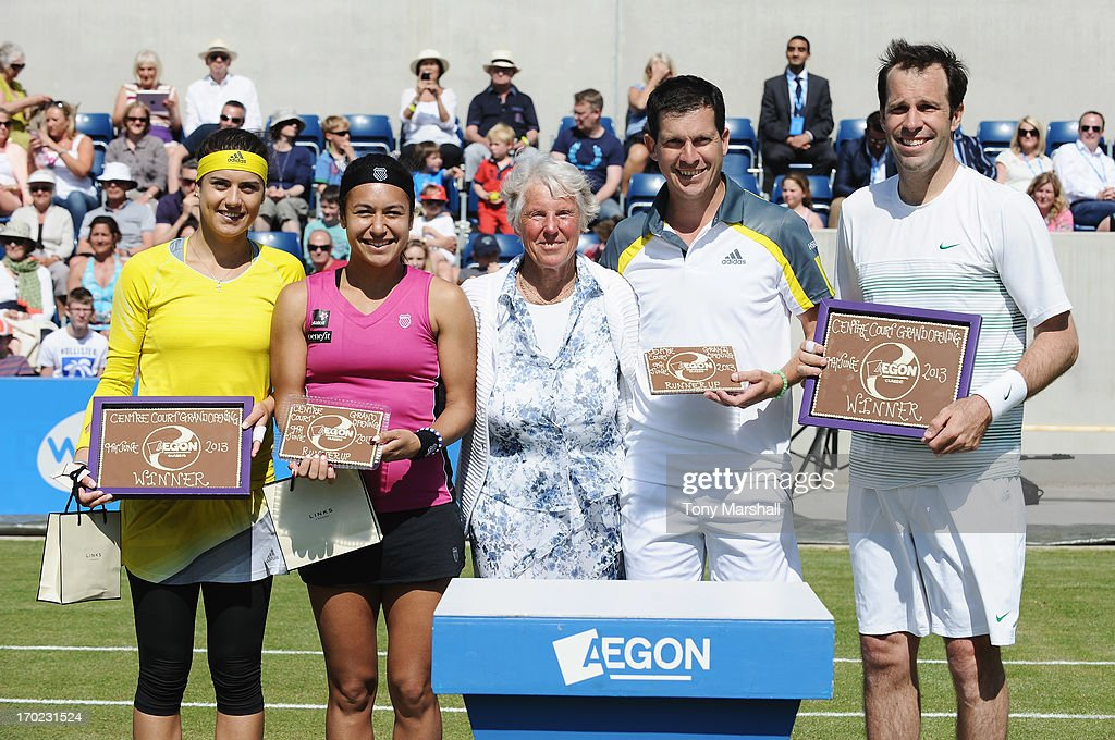 Winners Sorana Cirstea (L) of Romania and Greg Rusedski (R) of Great Britain pose with runners up Heather Watson (2ndL) and Tim Henman of Great Britain, their Cadbury World plaques and Ann Jones after their mixed doubles exhibition match during day one of the AEGON Classic tennis tournament at Edgbaston Priory Club on June 9, 2013 in Birmingham, England.