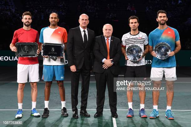 Winners Spain's Marcel Granollers and Rajeev Ram of the US second placed Netherlands' JeanJulien Rojer and Romania's Horia Tecau pose with their...