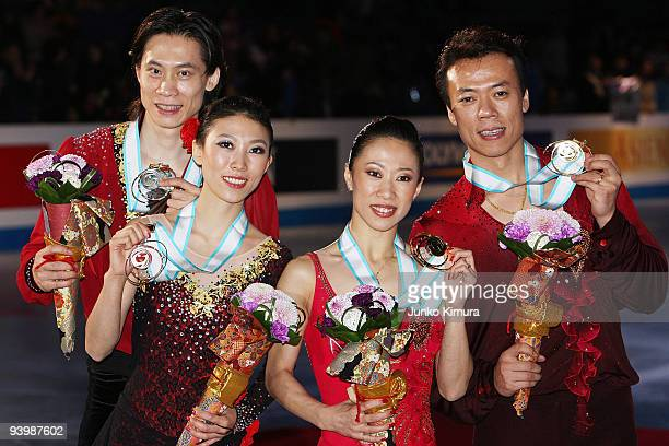 Winners Xue Shen and Hongbo Zhao of China and 2nd placed Qing Pang and Jian Tong of China pose with their medals after competing in the Pairs Free...
