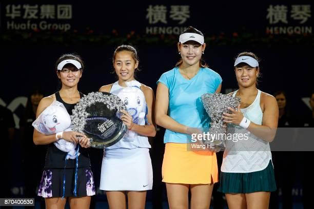 Winners Yingying Duan and Xinyun Han of China with runnersup Shuai Zhang and Jingjing Lu of China pose with their trophies following the Ladies...