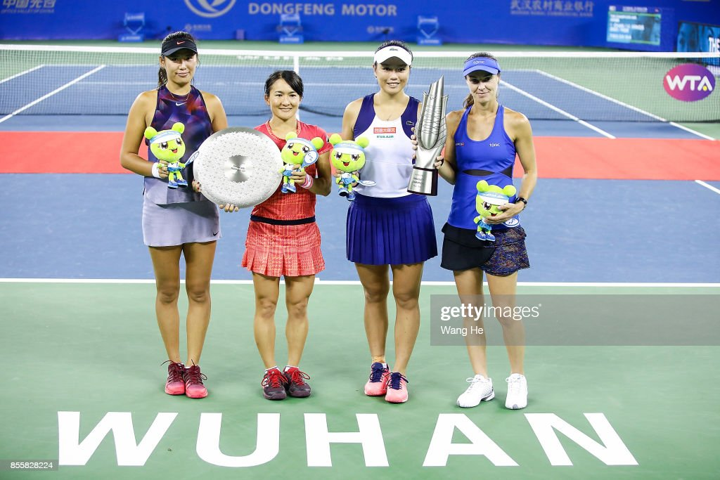 Winners Yung Jan Chan of Chinese Taipei and Martina Hingis of Switzerland with runners-up Shuko Aoyama of Japan and Zhaoxuan Yang of China pose with their trophies following the Ladies doubles final on day 7 of 2017 Dongfeng Motor Wuhan Open at Optics Valley International Tennis Center on September 30, 2017 in Wuhan, China.