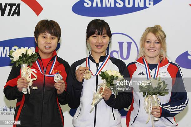 WinnerSeungHi Park of Korea 2nd PlaceMeng Wang of China 3rd PlaceElise Christie of Great Britain at ceremony of the Women's 1000m Final during the...