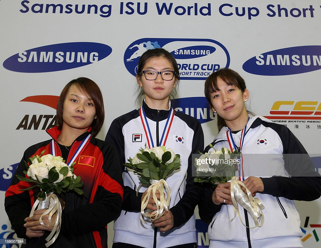 Suk Hee Shim of Korea (C), 2nd Place:Jianrou Li of China (L), 3rd Place:Ha-Ri Cho of Korea (R) at ceremony of the Women's 1500m Final during the day one of the ISU World Cup Short Track at the Oriental Sports Center on December 8, 2012 in Shanghai, China.
