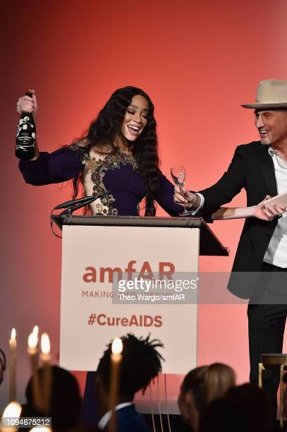 Winnie Harlow and Andrew Boose speak onstage during the amfAR New York Gala 2019 at Cipriani Wall Street on February 6 2019 in New York City