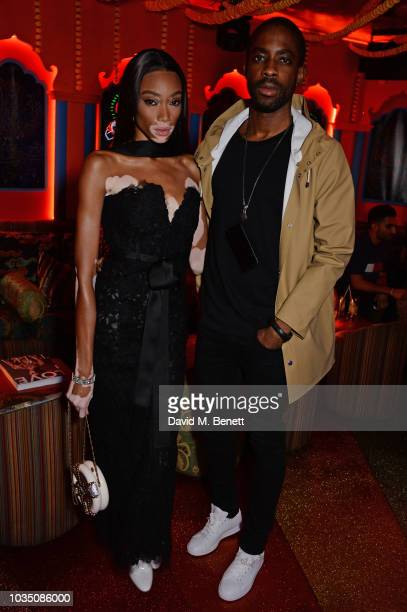 Winnie Harlow and Emmanuel Ezugwu attend the LOVE Magazine 10th birthday party with PerrierJouet at Loulou's on September 17 2018 in London England