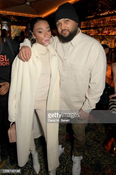 Winnie Harlow and guest attend the TOMMYNOW after party at Annabels on February 16 2020 in London England
