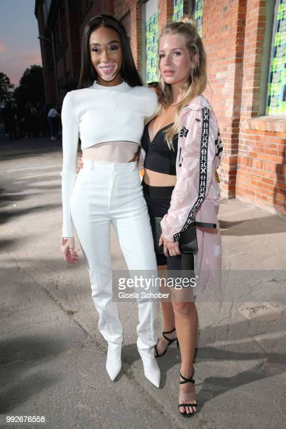 Winnie Harlow and Lottie Moss attend the HUGO show during the Berlin Fashion Week Spring/Summer 2019 at Motorwerk on July 5 2018 in Berlin Germany