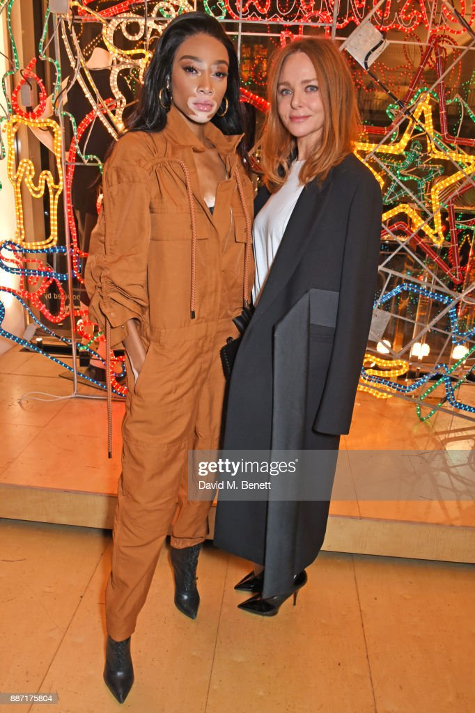 Winnie Harlow (L) and Stella McCartney attend the Stella McCartney Christmas Lights 2017 party on December 6, 2017 in London, England.