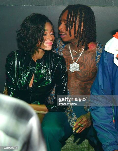Winnie Harlow and Wiz Khalifa attend the Dazed and Blazed Concert after Party at Elleven45 on August 22 2018 in Atlanta Georgia