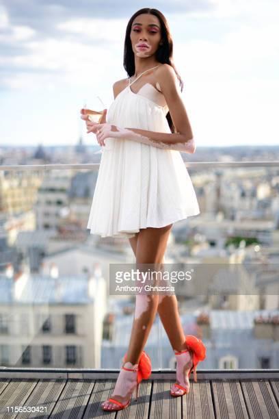Winnie Harlow attends Hypernature by PerrierJouet at Le Dernier Etage on June 17 2019 in Paris France