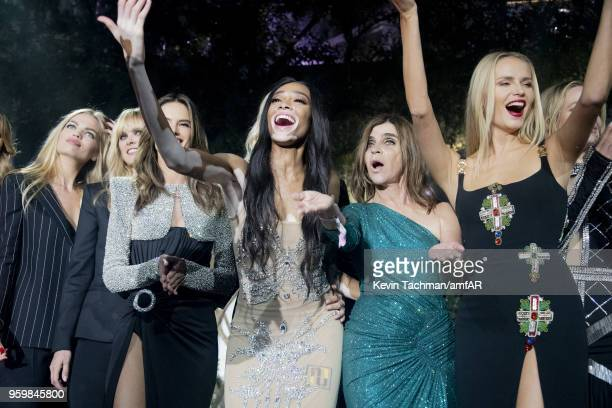 Winnie Harlow Carine Roitfeld Natasha Poly on stage at the amfAR Gala Cannes 2018 at Hotel du CapEdenRoc on May 17 2018 in Cap d'Antibes France