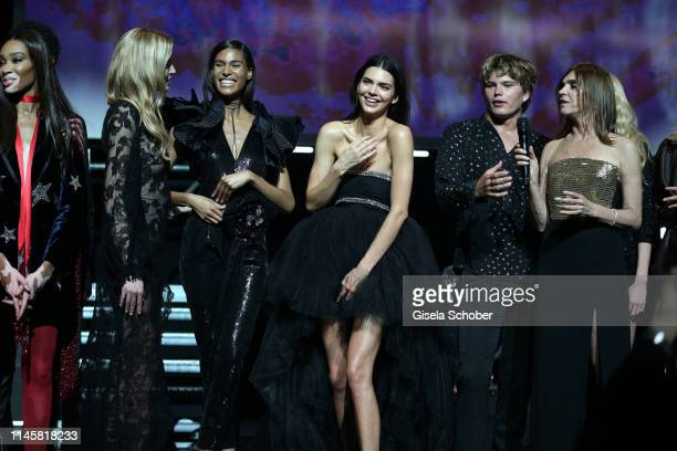 Winnie Harlow Cindy Bruna Kendall Jenner and Jordan Barret Carine Roitfeld attends the amfAR Cannes Gala 2019 at Hotel du CapEdenRoc on May 23 2019...