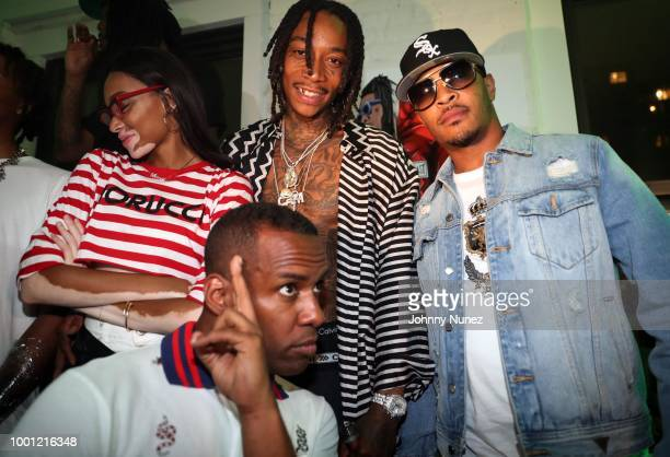 Winnie Harlow DJ Whoo Kid Wiz Khalifa and T I attend the Wiz Khalifa album release party on July 17 2018 in New York City