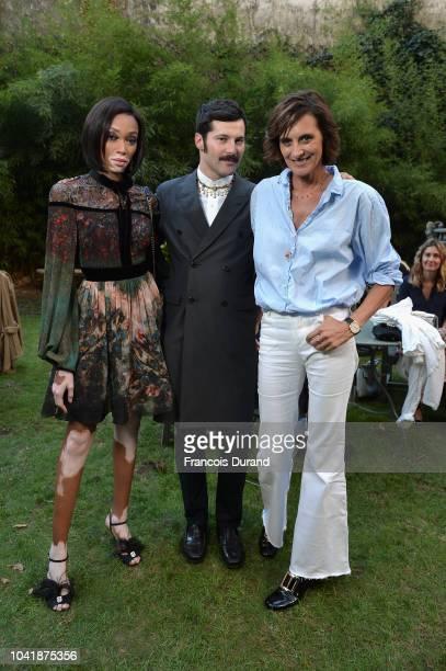Winnie Harlow Gherardo Felloni and Ines de la Fressange attend the Roger Vivier Presentation Spring/Summer 2019 during Paris Fashion Week on...