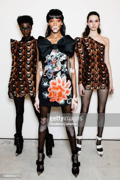 Winnie Harlow poses with models backstage ahead of the John Richmond show during Milan Menswear Fashion Week Autumn/Winter 2019/20 on January 13 2019...