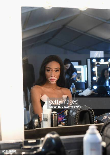 Winnie Harlow prepares backstage at Fashion for Relief Cannes 2018 during the 71st annual Cannes Film Festival at Aeroport Cannes Mandelieu on May 13...