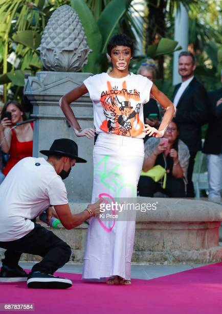 Winnie Harlow walks the runway at Philipp Plein Cruise Show 2018 during the 70th annual Cannes Film Festival on May 24 2017 in Cannes France