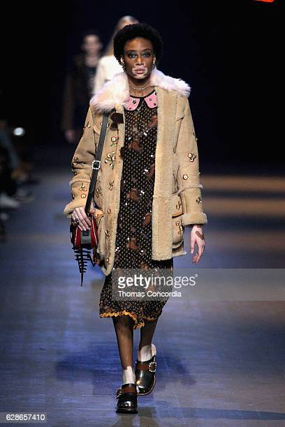 Winnie Harlow walks the runway at the Coach 75th Anniversary Women's PreFall and Men's Fall Show Runway on December 8 2016 in New York City
