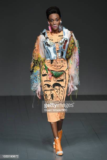 Winnie Harlow walks the runway at the Matty Bovan Show during London Fashion Week September 2018 at The BFC Show Space on September 14 2018 in London...