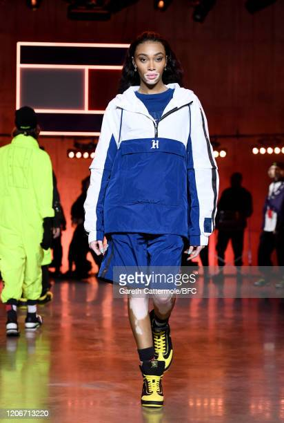 Winnie Harlow walks the runway at the TommyNow show during London Fashion Week February 2020 at the Tate Modern on February 16, 2020 in London,...
