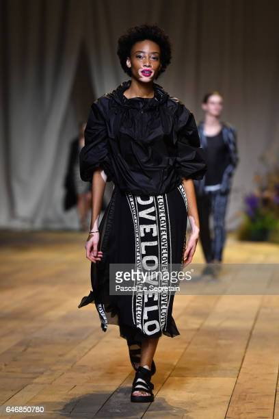 Winnie Harlow walks the runway during the HM Studio show as part of the Paris Fashion Week on March 1 2017 in Paris France