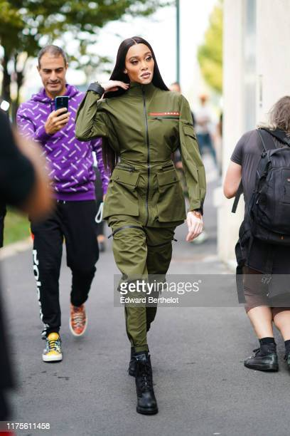 Winnie Harlow wears a green khaki military outfit, outside the Prada show during Milan Fashion Week Spring/Summer 2020 on September 18, 2019 in...