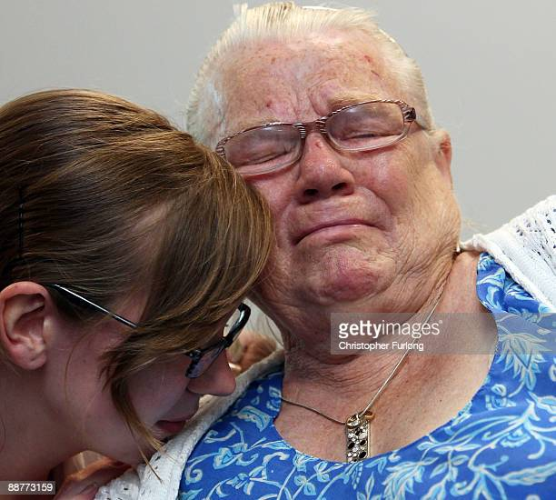 Winnie Johnson the mother of Saddleworth Moor murder victim Twelveyearold Keith Bennett is consoled by her friend Elizabeth Bond as she watches TV...