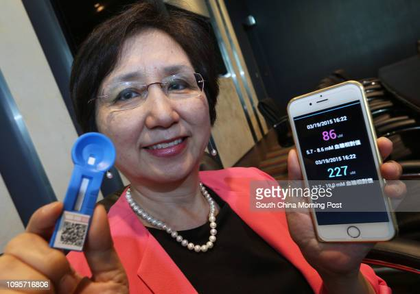 Winnie Lun Yuetseung CEO of eNano Health poses to photographer at Biotech Centre at Science Park in Sha Tin 03JUN15