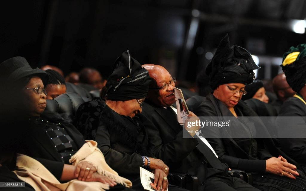 Winnie Madikizela Mandela with President Jacob Zuma during Madiba's State Funeral on December 15, 2013 in Qunu, South Africa. Nelson Mandela passed away on the evening of December 5, 2013 at his home. He is laid to rest at his homestead in Qunu during a State Funeral.