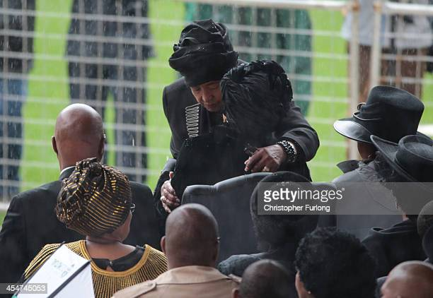 Winnie MadikizelaMandela and Graca Machel embrace as they arrive for the official memorial service for former South African President Nelson Mandela...