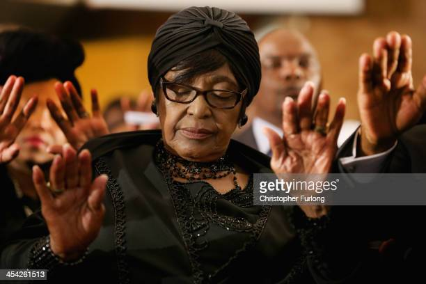 Winnie MadikizelaMandela exwife of former South Africa President Nelson Mandela prays as she attends a service at Bryanston Methodist Church during a...