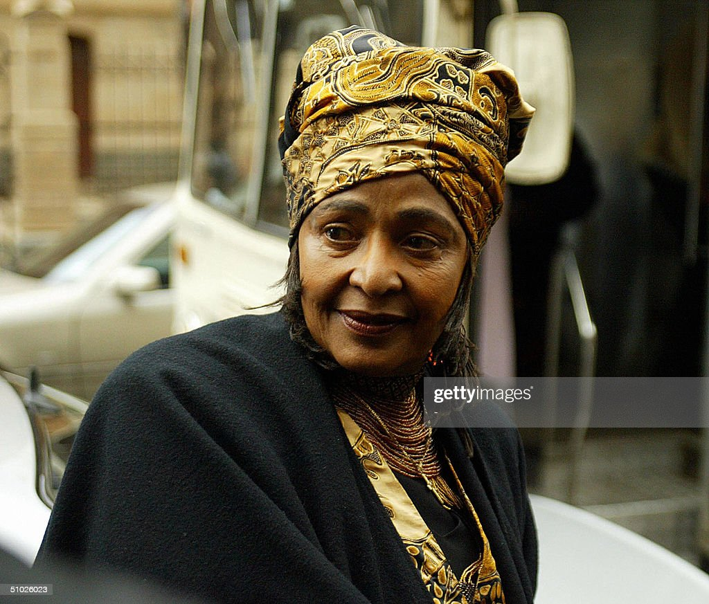 Winnie Madikizela-Mandela leaves Pretoira court 05 July 2004, after a South African judge scrapped a five-year jail sentence against the ex-wife of former president Nelson Mandela for theft and fraud in connection with bank loans she obtained for her employees.