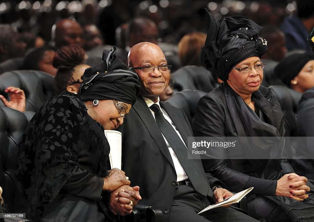 Winnie Madikizela-Mandela, President Jacob Zuma and Graca Machel during Madiba's State Funeral on December 15, 2013 in Qunu, South Africa. Nelson Mandela passed away on the evening of December 5, 2013 at his home. He is laid to rest at his homestead in Qunu during a State Funeral.