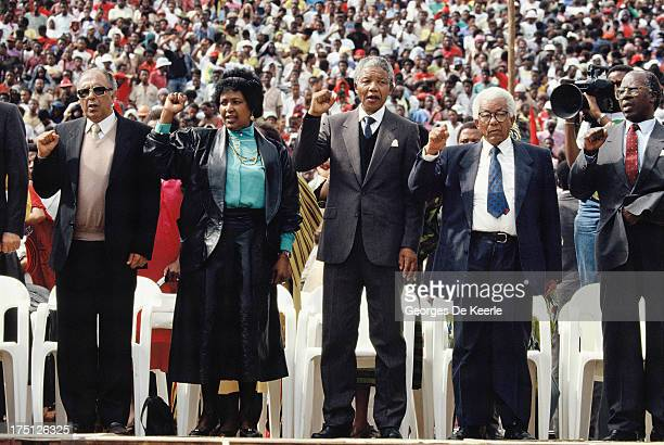 Winnie Mandela African National Congress leader Nelson Mandela and general secretary Walter Sisulu attend a rally in Soweto on February 13 1990 in...